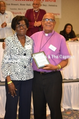 Bishop Reid receives a token for his work with Cursillo