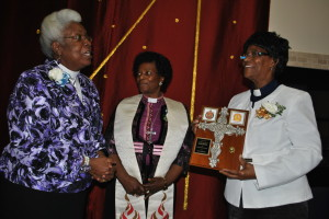 Bishop Wamukoya (centre) in the WOM stole with Rev. Jean Fairweather-Wilson (left) and the Rev. Canon Judith Daniel