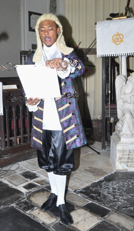 Jomo Aikens, dressed as a Town Crier, reads the 2013 Cathedral Sunday Proclamation