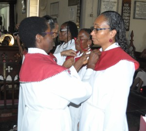 Sister Phyllis Thomas, Head of the Church Army (left), places the tippet on Associate Evangelist, Thera Edwards of the University Chapel, Mona