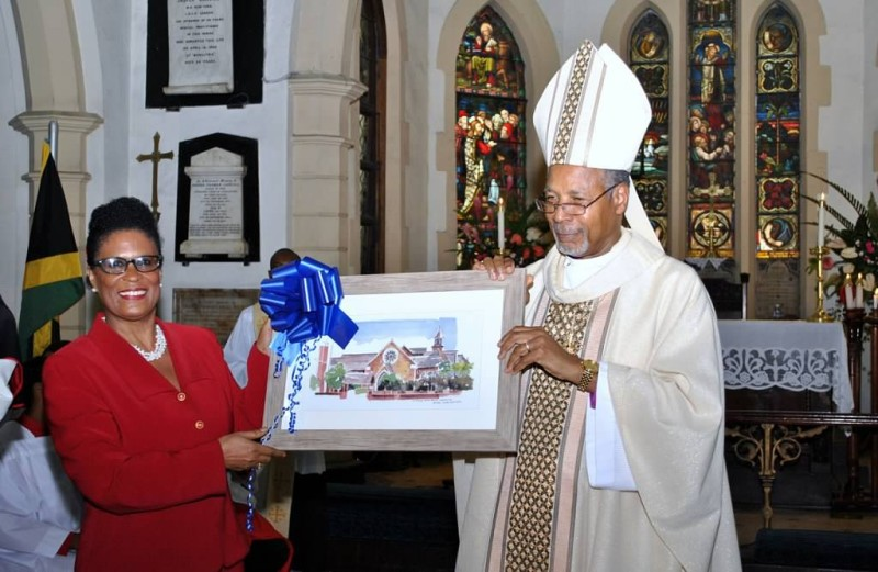 Mrs. Melrose King Smith, Secretary of the Church Committee, presents a framed print of the Church to the Archbishop.