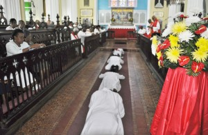 The Ordinands lie prostrate, signifying their submission to God.