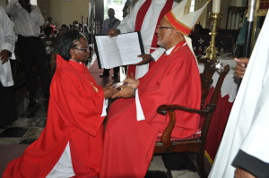 Rev. Marjorie Downer, newly-ordained Deacon, receives a copy of the New Testament from Bishop Gregory.