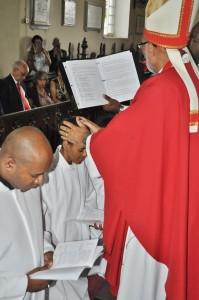 Bishop Gregory lays hands on the Rev. Natalie Blake during her Ordination.