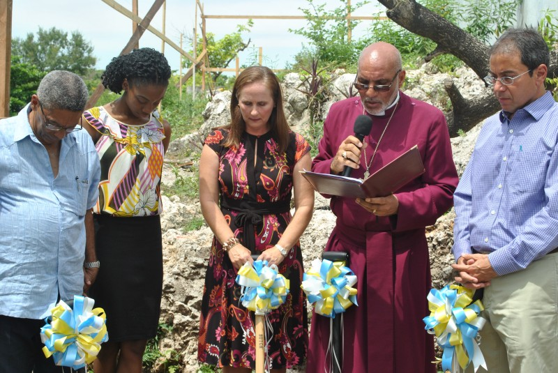 Bishop Howard Gregory (second right) blesses the site. From left are: Mr. Keith Sangster, Chairman of the Home; Miss Delate Howell, a resident; Mrs. Tanya Wildish, Board Member; and Mr. Andrew Mahfood, Chairman, Food for the Poor.