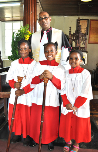 Canon Reid of the Cathedral with young Servers